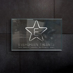 logo on the wall of evergreen model agency