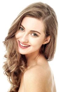 model smiling white background
